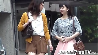 Small Japanese girls are jizz-swapping in a public bathroom